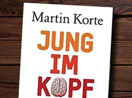 Man reading Korte's book