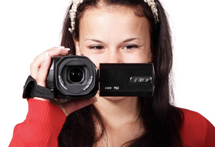 Woman pointing a video camera